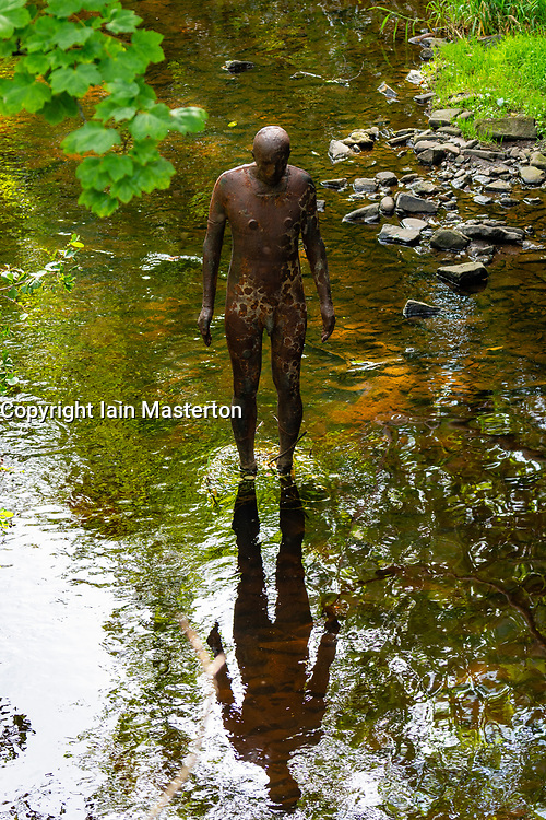 "Antony Gormley ""6 Times"" ""Ground"" sculpture in the Water of Leith in Edinburgh, Scotland, UK. comprising six life-size figures, positioned between the  the Scottish National Gallery of Modern Art and Leith Docks. - Editorial Use Only _"