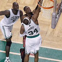 01 June 2012: Miami Heat shooting guard Dwyane Wade (3) is blocked by Boston Celtics small forward Paul Pierce (34) during the first half of Game 3 of the Eastern Conference Finals playoff series, Heat vs Celtics, at the TD Banknorth Garden, Boston, Massachusetts, USA.