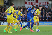 Tom Elliott forward for AFC Wimbledon (9) finds away through Accrington Stanley Football Club players during  the Sky Bet League 2 Play-Off first leg match between AFC Wimbledon and Accrington Stanley at the Cherry Red Records Stadium, Kingston, England on 14 May 2016. Photo by Stuart Butcher.