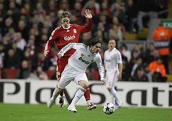 Fernando Gago slips past Fernando Torres..Uefa Champions League, First knock-out round, second leg..Liverpool v Real Madrid, Anfield..10.03.09.