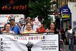 Newham, London. 05/07/2014<br /> Two of the Focus E15 Mothers, Sam Middleton, far left, and Jasmin Stone, centre, lead a protest through Newham. The Focus E15 Mothers campaign is a group of young single mothers who were placed into temporary accommodation by Newham council, after being evicted from council housing, but were warned they could be re-housed as far away as Birmingham, Manchester and Hastings. Some mothers have already relocated outside of London due to the lack of affordable social housing.<br /> Photo: Anna Branthwaite/LNP