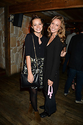 Left to right, sisters FLORENCE BULL and EMILY BULL at 'Bodo's Schloss Goes Wild For Lewa' held at Bodo's Schloss, 2A Kensington High St, London W8 on 9th October 2013.