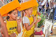 Eight-year-olds Kayla Tehrani, left, and Lala Schaldach enjoy some cheesy goodness at the Mac & Cheese Fest in Aspen, Colorado.