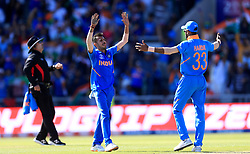 India's Yuzvendra Chahal (left) celebrates taking the wicket of West Indies' Jason Holder, caught by Kedar Jadhav, during the ICC Cricket World Cup group stage match at Emirates Old Trafford, Manchester.