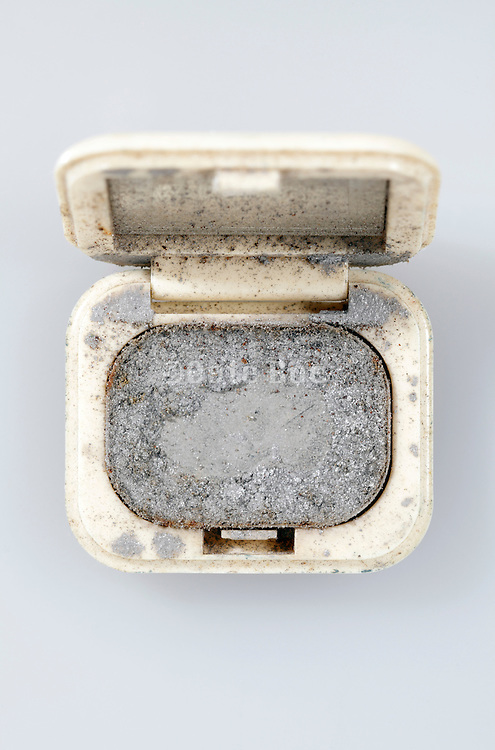 little old halve empty make up box with small mirror