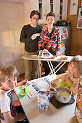 Weekday morning breakfast is a hurried, affable affair in the kitchen of Icelandic sculptor Ilmur Stefnsdottir and her partner, the actor Valur Freyr Einarsson. Youngest son Grettir, 2, is still asleep. The two older children, Salka, 8, and Sak, 7, ignore the fact that their mother is ironing bread on an ironing board.(Supporting image from the project Hungry Planet: What the World Eats) (MODEL RELEASED IMAGE)