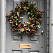 Christmas Wreath with decorations on front door in Greenwich Village.<br />