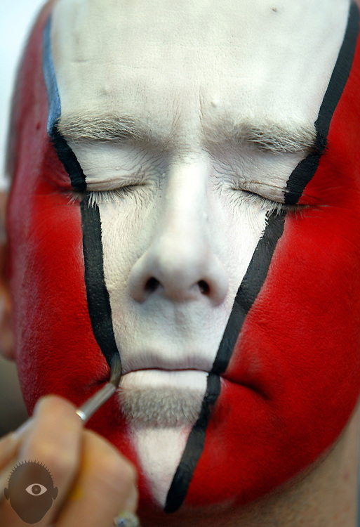 A big time Blazers fan Peter Lindberg has his face painted by makeup artist Reta Lindsley outside the Rose Garden. The Blazers beat the Rockets 107-103.. .