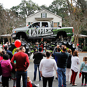 A Lather Construction, Inc.monstar truck sized Dodge cruises down Calhoun Street as onlooker snap photographs during the Bluffton Christmas Parade on December 6, 2014.