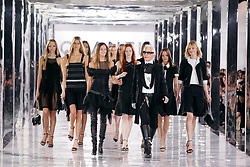 German fashion designer Karl Lagerfeld by models walks on the runway for Chanel Fall-Winter 2005-2006 ready-to-wear collection presentation in Paris, France, on March 4, 2005. Photo by Java/ABACA.