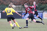 Deanna Cooper skips past Joise Green during the Women's FA Cup match between Watford Ladies FC and Brighton Ladies at the Broadwater Stadium, Berkhampstead, United Kingdom on 1 February 2015. Photo by Stuart Butcher.