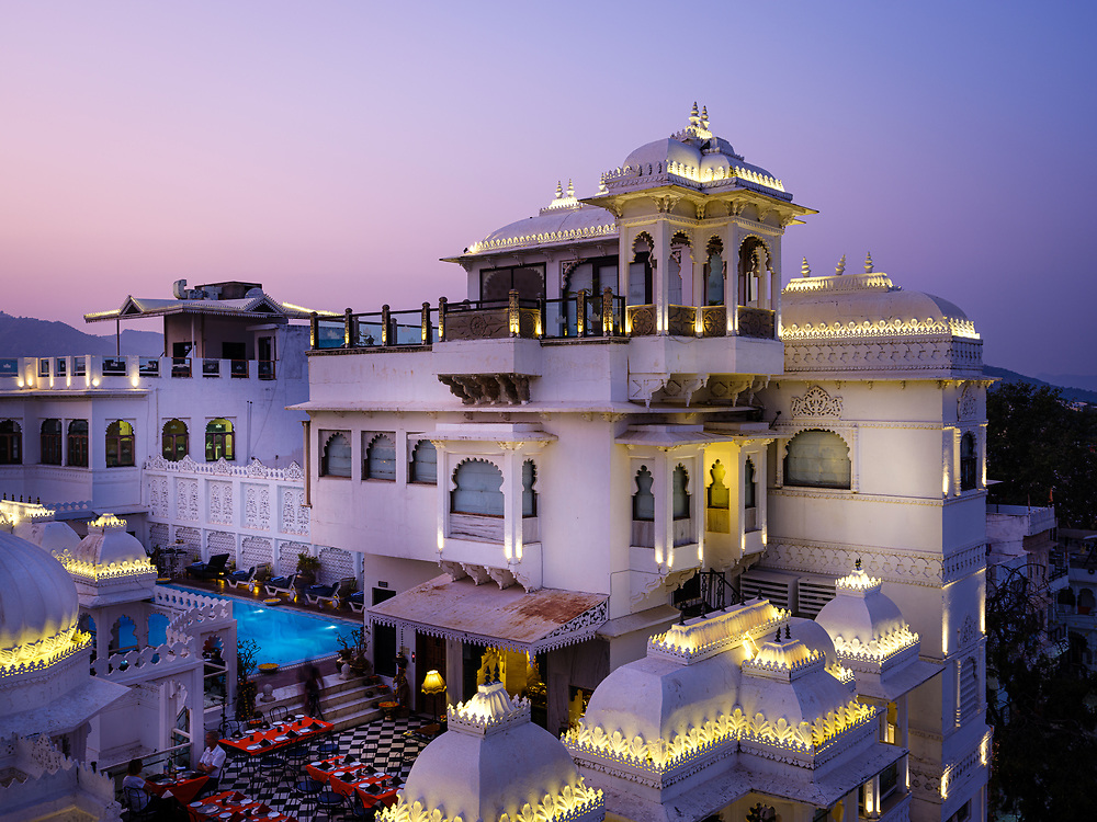 "UDAIPUR, INDIA - CIRCA NOVEMBER 2018:  Rooftop of the Hotel Udai Kothi in at night in Udaipur. The city is the historic capital of the kingdom of Mewar. Surrounded by Aravali Range, which separates it from Thar Desert, and full of lakes Udapiur is also known as the ""City of Lakes"" and dubbed as the most romantic spot of the Indian Continent."