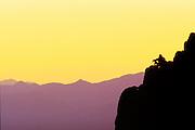 Hiker sitting enjoying the evening in the Tucson Arizona Desert.