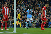 Manchester City striker Wilfried Bony celebrates scoring the equaliser during the Champions League Group D match between Manchester City and Sevilla at the Etihad Stadium, Manchester, England on 21 October 2015. Photo by Alan Franklin.