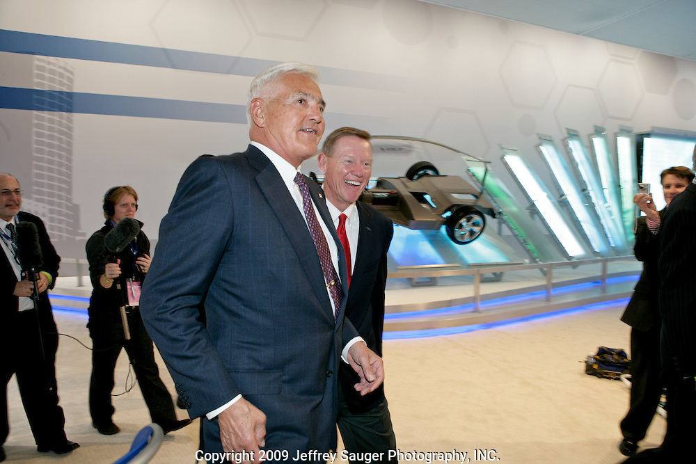 Robert Lutz, General Motors Vice Chairman, left, shares a laugh with Alan Mulally, president and chief executive officer of Ford Motor Company at the North American International Auto Show in Detroit, Michigan Sunday, January 11, 2009.