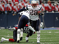 New England Patriot Corey Dillon breaks from the pack during the Pats-Bills match-up on 11 Dec 05, 1pm, Ralph Wilson Stadium, Orchard Park, NY