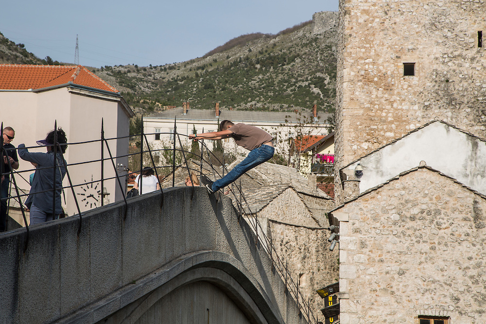 The Old Bridge (Stari Most) in Mostar, BiH. A Mostari man performs for tourists, offering to dive from the bridge for a set fee.<br /> <br /> Matt Lutton for the European Commission