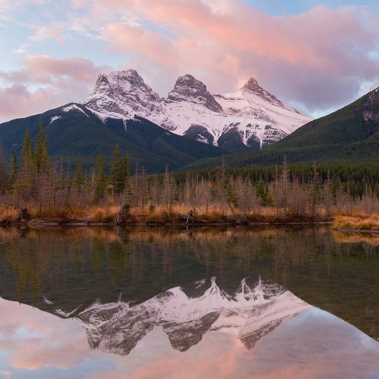 The famous Three Sisters in Canmore, Alberta taken from the reflecting pools on a beautiful morning.
