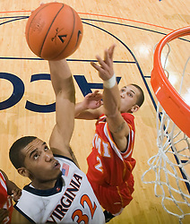 Virginia forward Mike Scott (32) goes up for a dunk over Virginia Military forward Willie Bell (2).  The Virginia Cavaliers defeated the Virginia Military Institute Keydets 107-97 in NCAA Basketball at the John Paul Jones Arena on the Grounds of the University of Virginia in Charlottesville, VA on November 16, 2008.