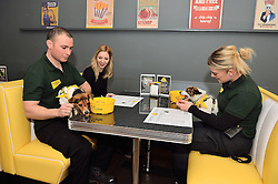 © Licensed to London News Pictures. 10/02/2016. Dogs being fed by their owners at tables at the MicroChippy VIP Launch Party which aims to raise awareness of the upcoming change in dog microchipping legislation. London, UK. Photo credit: Ray Tang/LNP