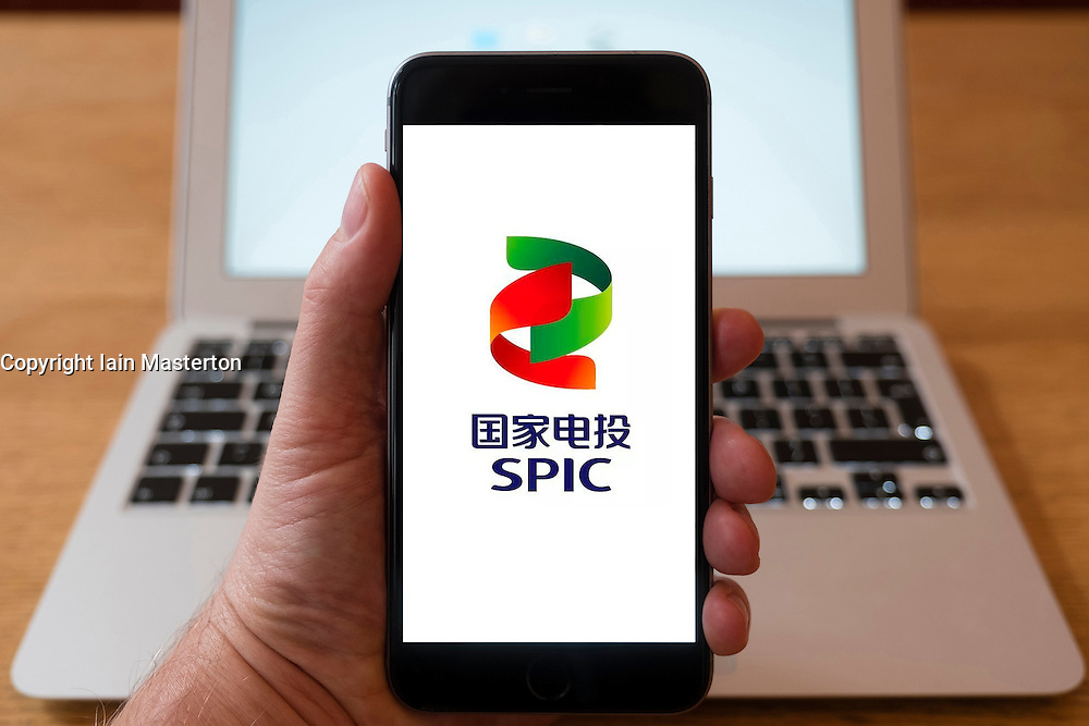 Using iPhone smartphone to display logo of SPIC, State Power Investment Corporation of China