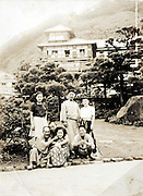 people casual posing in the garden of hotel during a trip Japan 1960s 1950s