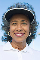 Woman wearing sun visor, portrait
