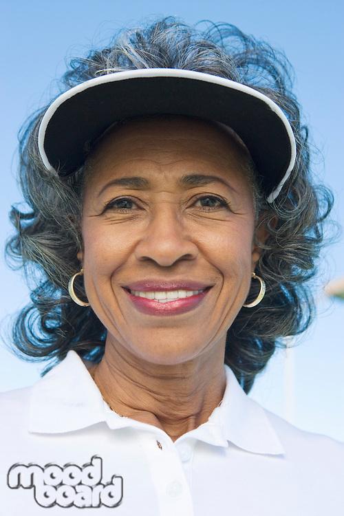 Woman wearing sun visor, portrait