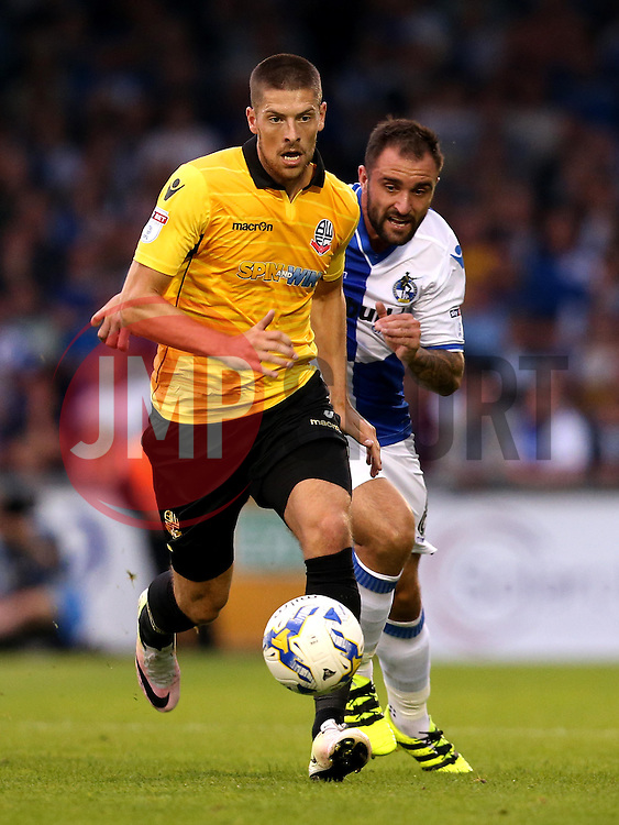 Jamie Proctor of Bolton Wanderers runs with the ball away from Peter Hartley of Bristol Rovers - Mandatory by-line: Robbie Stephenson/JMP - 17/08/2016 - FOOTBALL - Memorial Stadium - Bristol, England - Bristol Rovers v Bolton Wanderers - Sky Bet League One