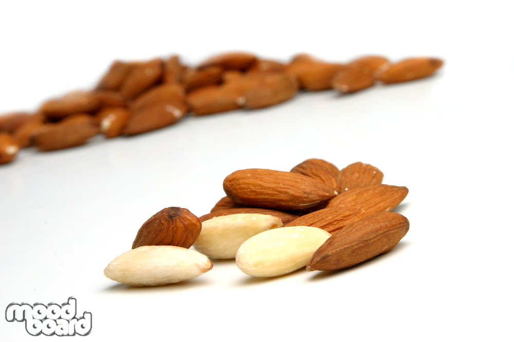 Close up almonds on white background