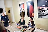 SLIEMA, MALTA - 8 FEBRUARY 2016: (L-R) Stage managers Dave McEvoy, Carrie Burnham and Rebecca Austin have a break after setting up the stage and the costumes of the touring Hamlet, performed by the Shakespeare's Globe theatre company, at the Salesian Theatre in Sliema, Malta, on February 8th 2016.<br /> <br /> The touring Hamlet, performed by the Shakespeare's Globe theatre company, is part of the Globe to Globe tour that set off in April 2014 (on the 450th anniversary of Shakespeare's birth) with the ambitious intention of visiting every country in the world over 2 years. The crew is composed of a total of sixteen men and women: four stage managers and twelve twelve actors  actors perform over two dozen parts on a stripped-down wooden stage. So far Hamlet has been performed in over 150 countries, to more than 100,000 people and travelled over 150,000 miles. The tour was granted UNESCO patronage for its engagement with local communities and its promotion of cultural education. Hamlet was also played for many dsiplaced people around the world. It was performed in the Zaatari camp on the border between Syria and Jordan, for Central African Republic refugees in Cameroon, and for Yemeni people in Djibouti. On February 3rd it was performed to about 300 refugees in Calais at the camp known as the Jungle.
