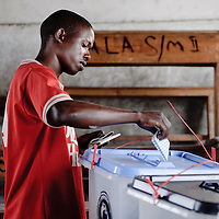 Dar Es Salaam, Tanzania 31 October 2010<br /> A Tanzanian citizen casts his vote in a polling station of Dar Es Salaam during the presidential election day.<br /> The European Union has launched an Election Observation Mission in Tanzania to monitor the general elections, responding to the Tanzanian government invitation to send observers for all aspects of the electoral process.<br /> The EU sent this observation mission led by Chief Observer David Martin, a member of the European Parliament. <br /> PHOTO: EZEQUIEL SCAGNETTI