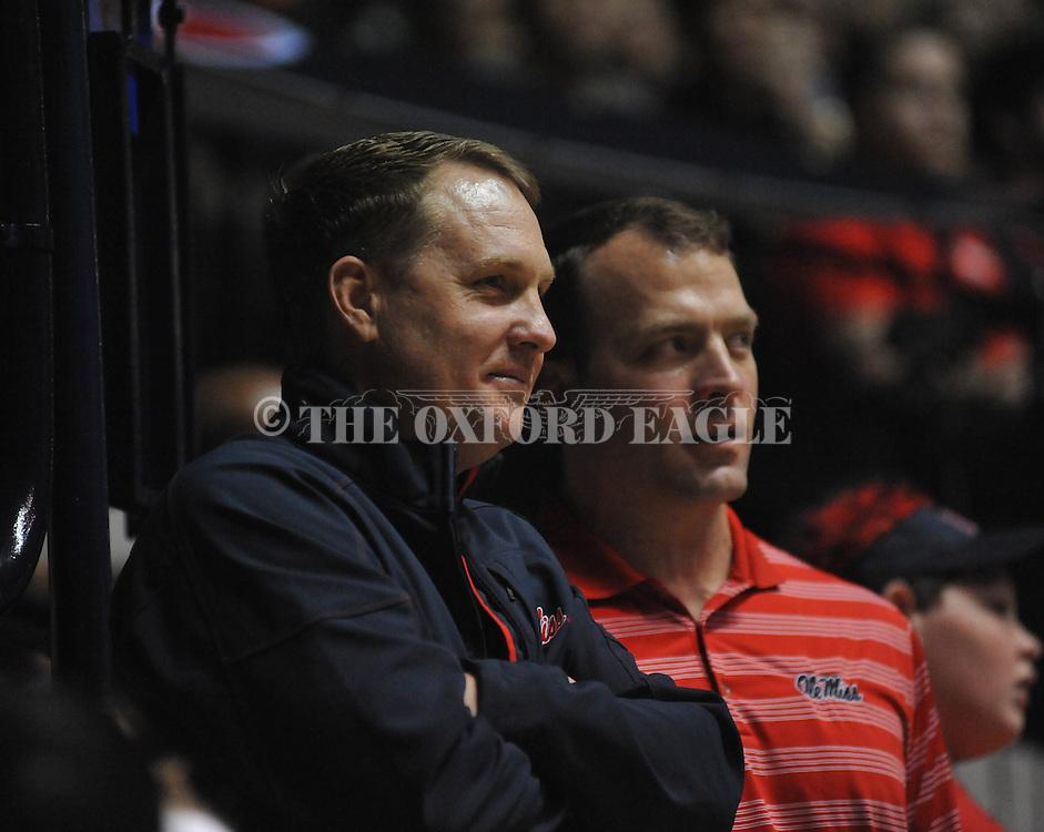 "Ole Miss head football coach Hugh Freeze (left) and athletic director Ross Bjork vs. Missouri at the C.M. ""Tad"" Smith Coliseum on Saturday, January 12, 2013. Ole Miss defeated #10 ranked Missouri 64-49."