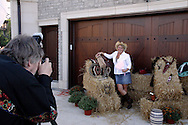 Jerry Huffman of Centerville (left) takes the photo of Michele Mandelik of Dayton during the 2010 Cattle Baron's Ball at the home of David and Shery Oakes in Centerville, Saturday, August 28, 2010.