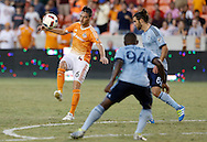 Jun 29, 2016; Houston, TX, USA; Houston Dynamo midfielder David Rocha (6) chips against Sporting Kansas City midfielder Graham Zusi (8) in the second half at BBVA Compass Stadium. Dynamo won 3 to 1. Mandatory Credit: Thomas B. Shea-USA TODAY Sports