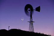 Spinning windmill water pump at dawn between Warm Springs and Tonopah.  Near Area 51, Nevada. (1999)