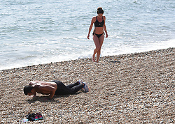 © Licensed to London News Pictures. 24/04/2020. Brighton, UK. People exercising on Brighton seafront at Brighton and Hove, during a pandemic outbreak of the Coronavirus COVID-19 disease.  Photo credit: Liz Pearce/LNP