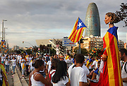 People waving red and yellow striped Catalan flags for Catalan National Day on September 11, 2015, Barcelona, Spain. The upcoming regional elections on September 27, 2015 should reactivate the independence of Catalonia from Spain. National Day, or Diada, in fact, marks the defeat of Catalan forces on September 11, 1714, at the hands of Philip V of Spain after a 13-month siege of Barcelona. Picture by Manuel Cohen