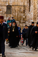 A procession of Greek Orthdox priests including the Greek Orthodox Patriarch of Jerusalem arrives at the Church of the Holy Sepulchre (site of the last five stations of the Cross and venerated as the place where Jesus was crucified and buried), the Christian Quarter, Old City, Jerusalem, Israel.
