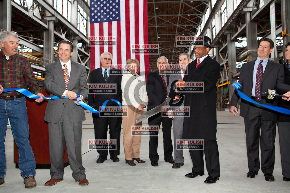 VIP's cut the the ceremonial  ribbon, before hundreds of attendees from throughout the region to mark the official opening of the Allied Defense Recycling, Mare Island Dry Docks.