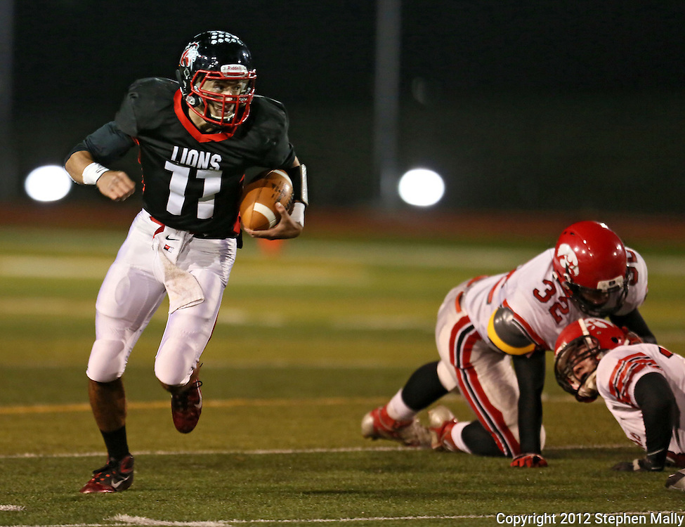 Linn-Mar's Rhys Davis (11) looks downfield on a run during during the game between the Iowa City High Little Hawks and the Linn-Mar Lions at Linn-Mar Stadium in Marion on Friday October 12, 2012.