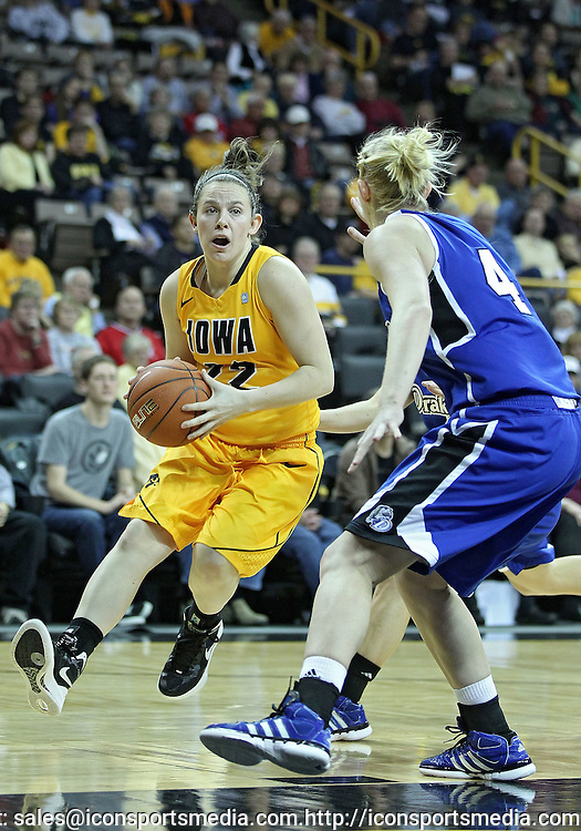 December 20, 2011: Iowa Hawkeyes guard Samantha Logic (22) drives with the ball as Drake Bulldogs guard Kyndal Clark (4) defends during the NCAA women's basketball game between the Drake Bulldogs and the Iowa Hawkeyes at Carver-Hawkeye Arena in Iowa City, Iowa on Tuesday, December 20, 2011. Iowa defeated Drake 71-46.