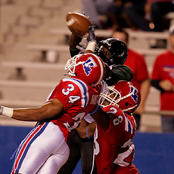 Sep 30, 2009; Ruston, LA, USA; Hawaii Warriors wide receiver Rodney Bradley (3) is defended in the endzone by Louisiana Tech Bulldogs safety Antonio Baker (34) and cornerback Terry Carter (28) during the second half at Joe Aillet Stadium. Louisiana Tech defeated Hawaii 27-6. Mandatory Credit: Derick E. Hingle-US PRESSWIRE