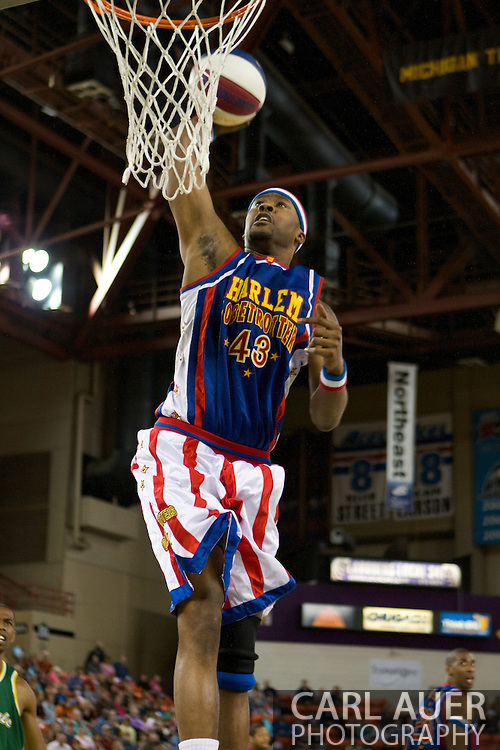 April 30th, 2010 - Anchorage, Alaska: Harlem Globetrotter Hawk (43) elevates for a thunderous dunk Friday night at the Sullivan Arena.