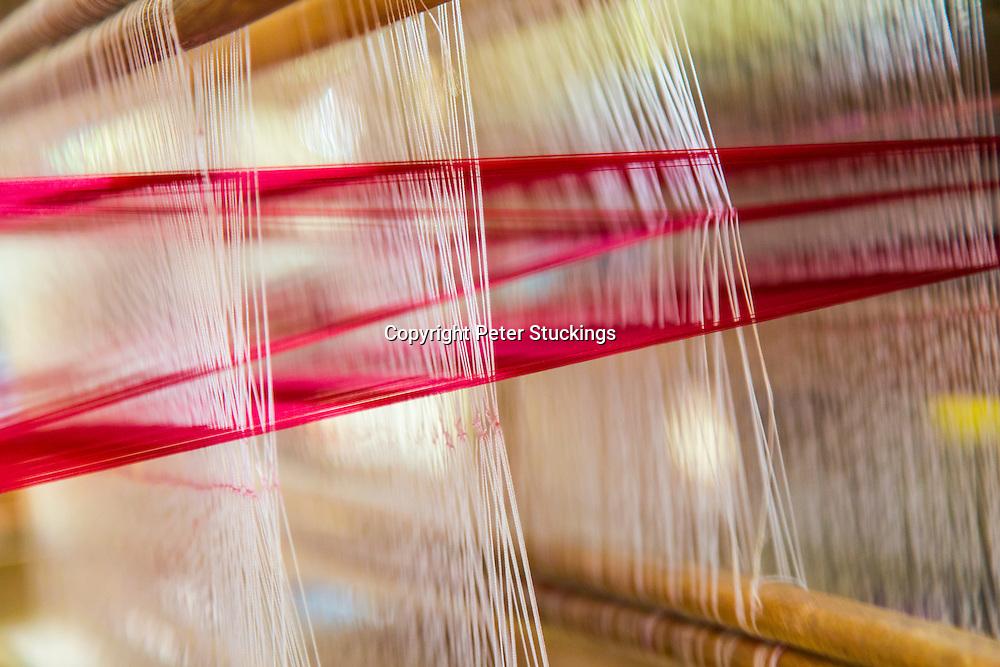 Silk threads on a weaving loom in a silk workshop, Siem Reap, Cambodia