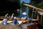 Boating crew at Gay's Staithe on Barton Broad, a Norfolk Wildlife Trust Nature Reserve. Gay's Staithe lies along the western arm of Barton Broad known as Limekiln Dyke, once a calling point for wherriy boats carrying corn, coal and reeds for the thatching industry and named after Billy Gay whose trading wherry business operated from here.