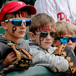 Mar 3, 2013; Sarasota, FL, USA; Philadelphia Phillies fans Weston Stoltzfus, 9 years old and Benson Stoltzfus 7 years old and Chandler Stoltzfus 6 years old watch from the stands before a spring training game against the Baltimore Orioles at Ed Smith Stadium. Mandatory Credit: Derick E. Hingle-USA TODAY Sports