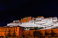 The Potala Palace (a UNESCO World Heritage Site) at night. The palace was the chief residence of the Dalai Lama until the 14th Dalai Lama fled to Dharamsala, India, during the 1959 Tibetan uprising. The massive palace contains 999 rooms. Lhasa, Tibet, China.
