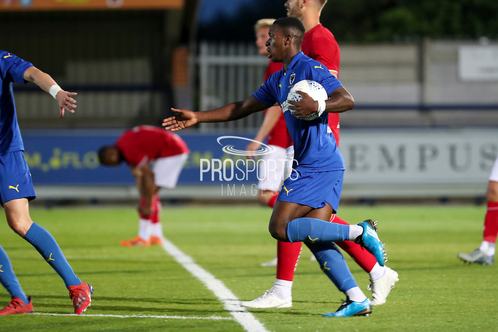 AFC Wimbledon attacker Michael Folivi (17) celebrating after scoring goal during the Pre-Season Friendly match between AFC Wimbledon and Bristol City at the Cherry Red Records Stadium, Kingston, England on 9 July 2019.