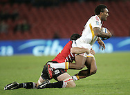 JOHANNESBURG, SOUTH AFRICA - 23 April 2011: Lelia Masaga of the Chiefs is tackled by Cobus Grobbelaar during the Super Rugby Match between the MTN Lions and the Chiefs held at Coca Cola Park Stadium, Johannesburg, South Africa. Photo by Dominic Barnardt